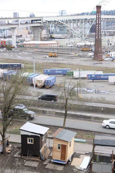 TRIBUNE PHOTO: LYNDSEY HEWITT - A springtime photo shows the tiny wooden structures across from the railyard.