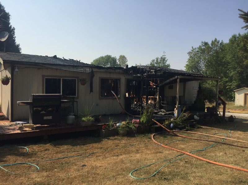 CONTRIBUTED PHOTO: CLACKAMAS COUNTY FIRE DISTRICT - Damage to the multi-family manufactured home leaves eight people without shelter. The Red Cross has intervened.