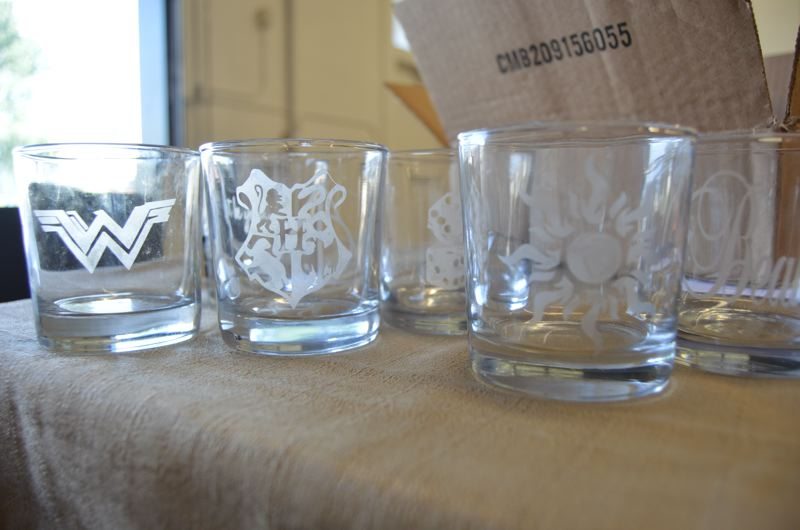 SPOTLIGHT PHOTO: NICOLE THILL - A row of etched glass drinking cups were just some of the creations designed by students in the iDesign Workshop. Students in the workshop learned to create a variety of art pieces including fabric prints, vinyl stickers and metal working during the week.