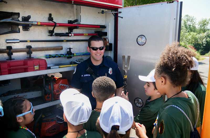 COURTESY PHOTO: CITY OF HILLSBORO - Campers surround Hillsboro firefighter Nick Johnson as he gives them a tour of a fire truck on day one of Camp Eagle.