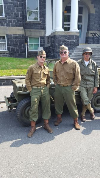THAD SMITH PHOTO - A group in World War II period uniforms adds to the authenticity of a Liberty Convoy of restored war-era military vehicles that drove from St. Helens to Scappoose for Wings & Wheels. Pictured left to right: Scappoose residents Brandon Smith, Thad Smith and Joe Rozanek.