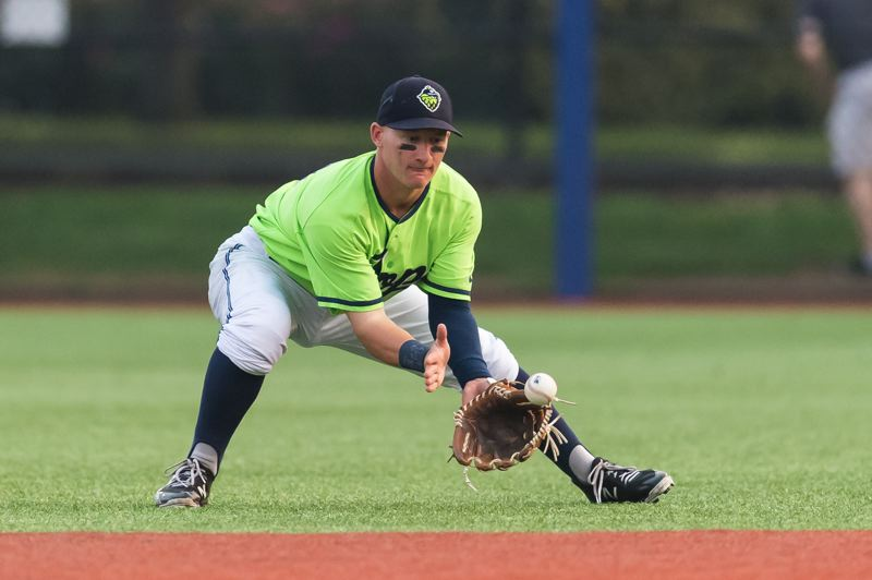 HILLSBORO TRIBUNE PHOTO: CHRISTOPHER OERTELL - Hillsboro Hops infielder Camden Duzenack (41) grabs a ground ball during a Minor League baseball game against the Salem-Keizer Volcanoes at Ron Tonkin Field in Hillsboro, Oregon.