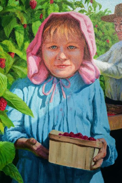 OUTLOOK PHOTO: JOSH KULLA - In perhapst the most striking feature of Don Gray's latest mural, a young girl gazes directly at the viewer while holding a crate of raspberries.