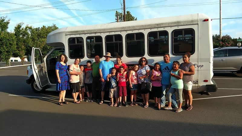 CONTRIBUTED PHOTO - Proud volunteers gather around a old Elks Club bus that will be converted into a mobile art studio. 'Art is a good way to help heal children, families and communities from trauma,' one participant wrote in Spanish.