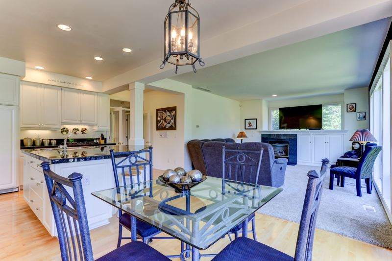 COURTESY PHOTO: LEGACY REALTY GROUP - Another view of the kitchen nook and family room in this two-level home in Gresham's exclusive Persimmon neighborhood.