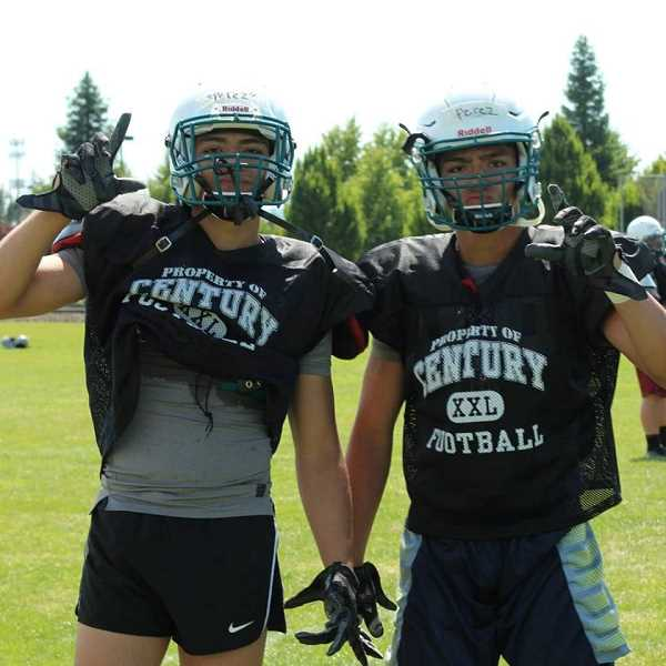 COURTESY PHOTO - Century football players Anthony and Andre Perez pose for a photo during the Linfield team camp last month in McMinnville.