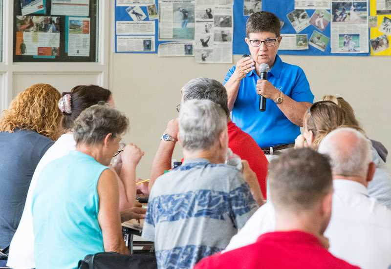 LON AUSTIN/CENTRAL OREGONIAN - Becky Oakes, a spokesperson for the National Federation of State High School Associations, speaks to a group of more than 40 volleyball officials Saturday morning in the Crook County High School cafeteria.