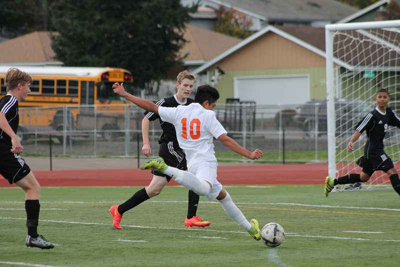 PIONEER PHOTO: CONNER WILLIAMS - Molalla junior Miguel Maldonado scores one of his four goals against Cascade during their play-in matchup last season; the Indians won 4-2 and secured their spot in the Class 4A playoffs.