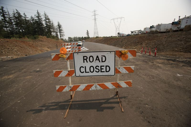 TIMES PHOTO: JAIME VALDEZ - On Monday, this sign will go down and new 'road closed' signs will go up on Tonquin Road, as the first phase of Basalt Creek Parkway opens to traffic as an alternate route.