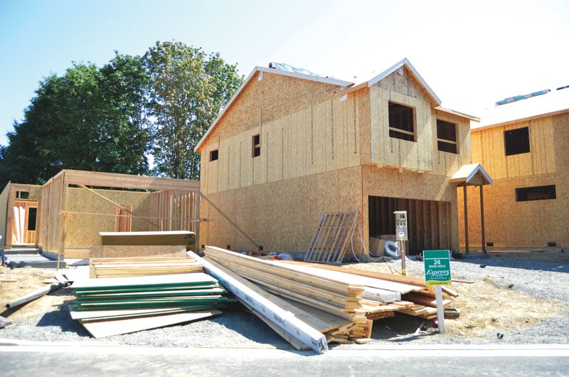 SPOTLIGHT FILE PHOTO - A home construction site in Scappoose is the subject of DEQ penalties for an alleged lack of soil and erosion control, as well as pollution to a nearby wetland. D.R. Horton, the home builder, has also been fined by another state agency for developing in a wetland without proper permits.