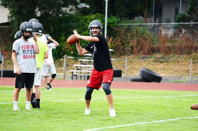 SPOTLIGHT PHOTO: JAKE MCNEAL - Indians senior quarterback Jerad Toman winds up a pass.