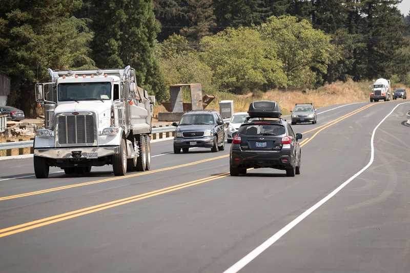 PAMPLIN MEDIA GROUP: JAIME VALDEZ - Traffic was flowing freely along the new Basalt Creek Parkway by early Monday afternoon. The opening was delayed for a short time in an effort to finish last-minute striping.
