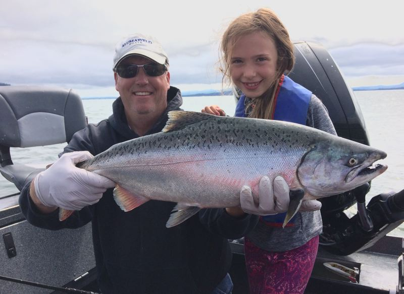 SUBMITTED - Katri Rees, age 8 of Oregon City, with her first salmon from the lower Columbia River taken on Saturday, August 12.