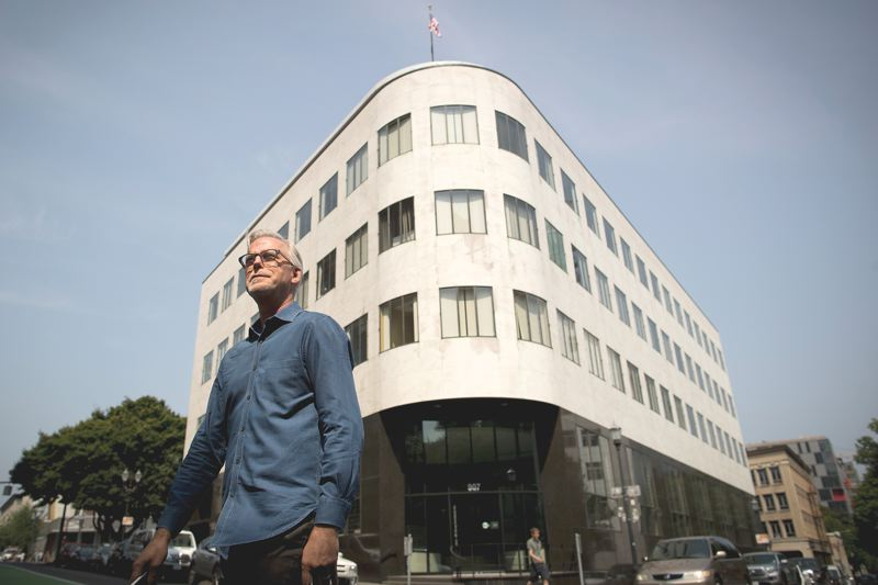 JAIME VALDEZ - David Wark is chair of the citys Design Commissio is AIA principal architect at Portland-based Hennebery Eddy Architects. His company worked on the remodel of The Reserve Bank behind him.