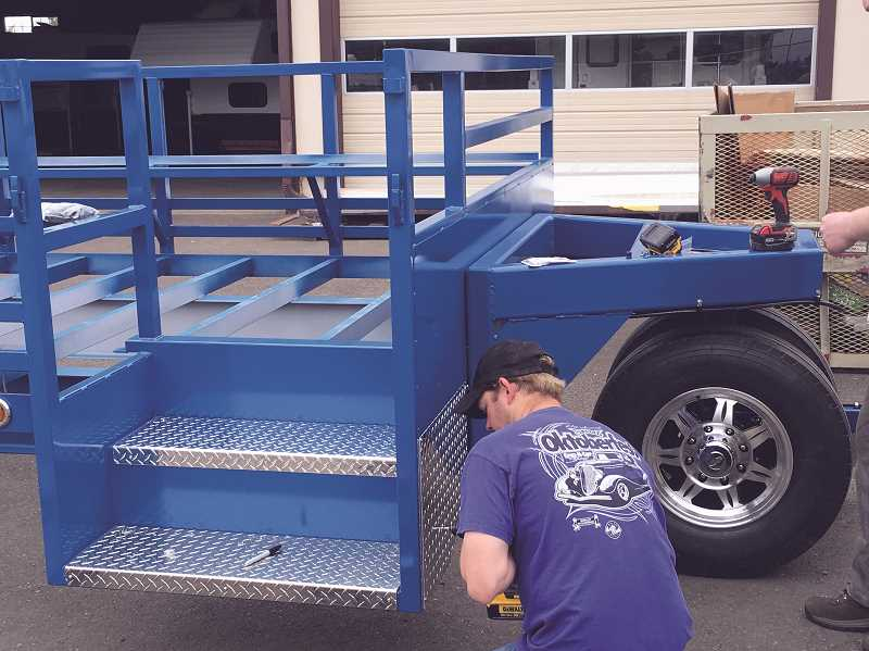 COURTESY PHOTO - A student with Chemeketa Community College's Career Technical Education program works on putting together a trailer to be used at this year's Oktoberfest as a shuttle for guests.