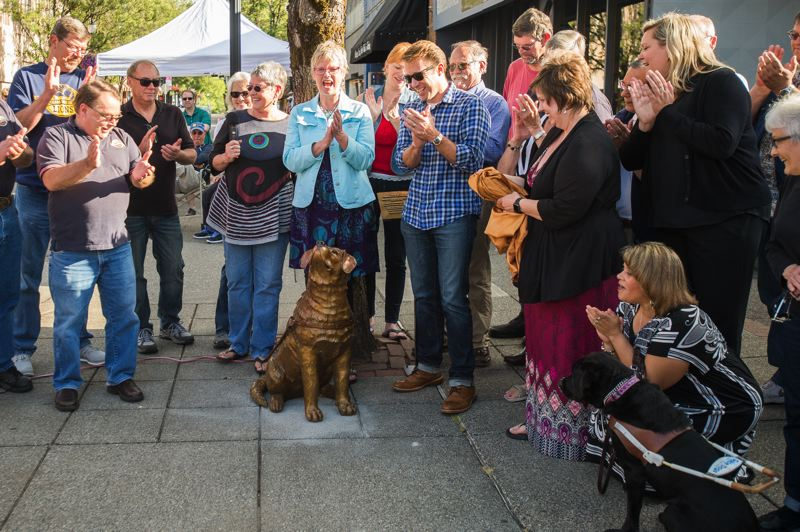 OUTLOOK PHOTO: JOSH KULLA - 'Driscoll' is a bronze statue at the corner of Main Avenue and Third Street that honors Guide Dogs for the Blind, a program that holds training sessions in downtown Gresham. The sculpture was unveiled in July 2016 at a well-attended ceremony.
