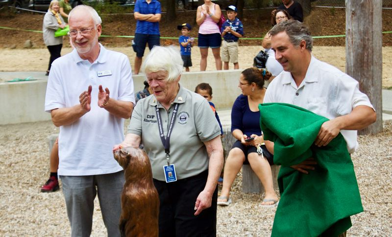 OUTLOOK PHOTO: CHRISTOPHER KEIZUR - From left, Gresham City Councilor David Widmark, Joan Albertson and artist Rip Caswell unveil one of Nadaka Nature Park's new bronze statues.