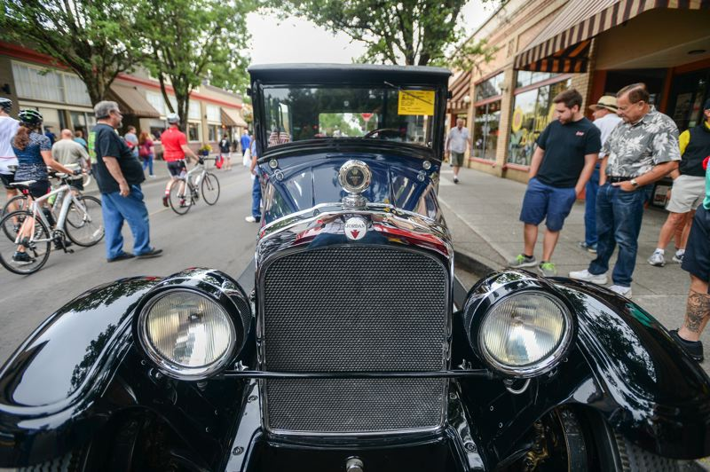 OUTLOOK PHOTO: JOSH KULLA - Les Lunceford owns this rare blue 1927 Jordan J, which he happily showed off to passersby Saturday during Rockin' Round the Block in downtown Gresham.
