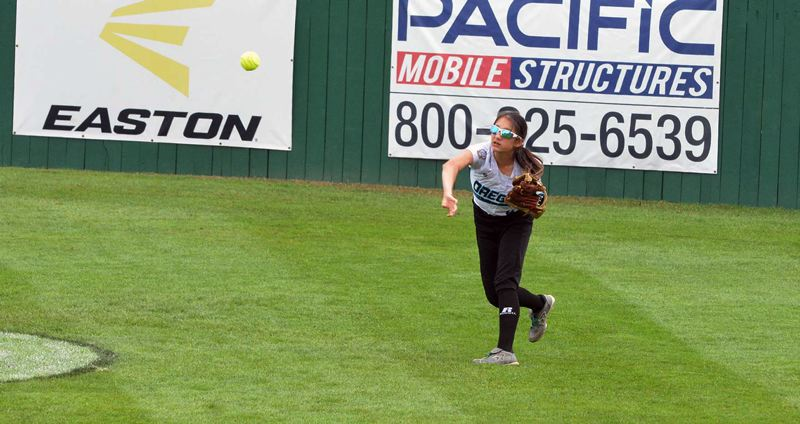 TIMES PHOTO: MATT SINGLEDECKER - South Beaverton outfielder Allison Olivo throws a ball back in toward the infield against Team East.