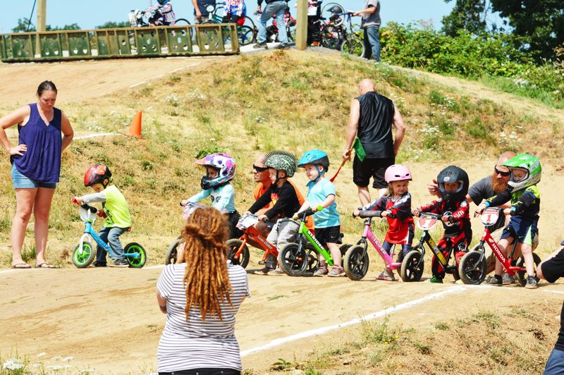 SPOTLIGHT PHOTO: JAKE MCNEAL - Balance bike riders, five years and younger, line up just before the start of a race.