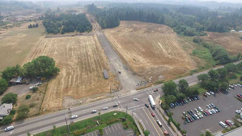 COURTESY OF ALVARO FONTAN - Work on the Sherwood portion of 124th Avenue (looking south here) at Tualatin-Sherwood Road is continuing with plans to open in the Spring of 2018. To the west of the graded property is the Tonquin Employment Area, a 300-acre parcel of land earmarked for light to mid-size manufacturing companies inside Sherwood city limits.