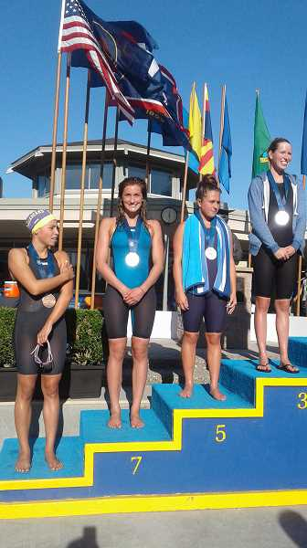 COURTESY PHOTO - Viking senior-to-be Cali Rowland stands on the podium to accept her 7th place trophy at the 2017 USA Swimming Futures meet Aug. 3-6 in Santa Clara, Calif.