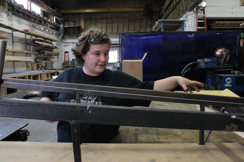 TRIBUNE PHOTO: LYNDSEY HEWITT - Crystal Potter started working on her homemade vehicle last week. She says she is a natural procrastinator and always likes to wait until the last minute to start work.