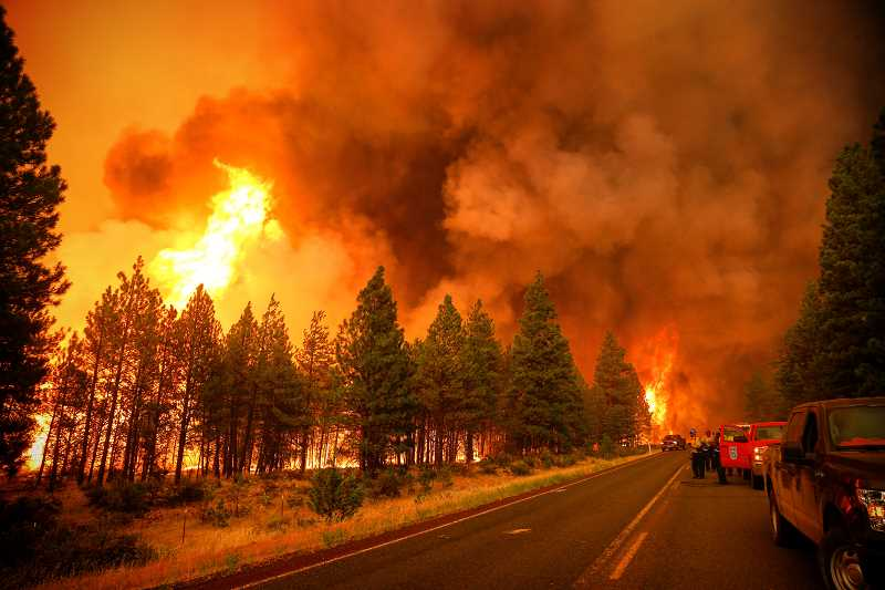 EDWARD HEATH - The Nena Springs Fire, which has burned 39,526 acres, got started on private property in Wasco County and spread to the Warm Springs Reservation on Aug. 8. Flames from the fire light up the sky on Aug. 11, as the fire rapidly expanded. The fire is now 90 percent contained.