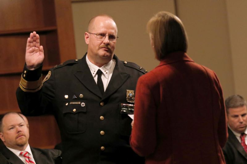 TRIBUNE FILE PHOTO - Former chief Larry O'Dea, shown at his swearing-in in January 2015, would be getting fired right now if he hadn't retired last year, according to a letter from Mayor Ted Wheeler