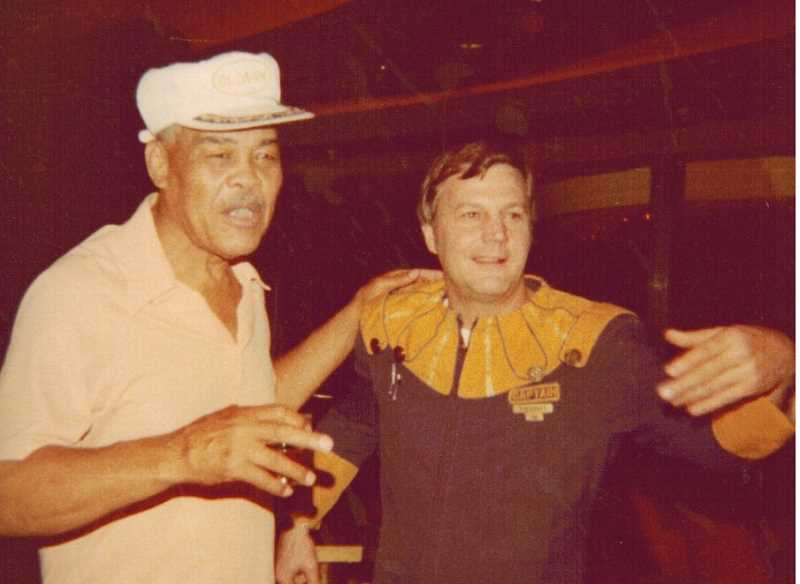COURTESY OF TOMMY NINE - Tommy Nine (right, dressed as a jester) poses with Joe Lewis, known as the 'Brown Bomber,' at Caesars Palace.