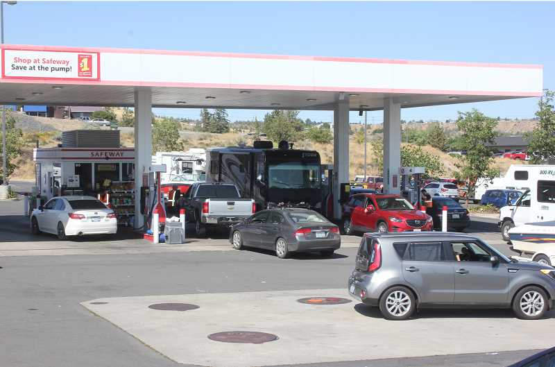 SUSAN MATHENY/MADRAS PIONEER - Cars and motorhomes were lined up at the Safeway gas station on Thursday, Aug. 17.