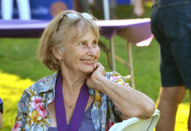 SPOKESMAN PHOTO: VERN UYETAKE - Wilsonville cancer survivor Jackie Aden relaxes and enjoys the festivities at the Evening of Hope Thursday, Aug. 17.
