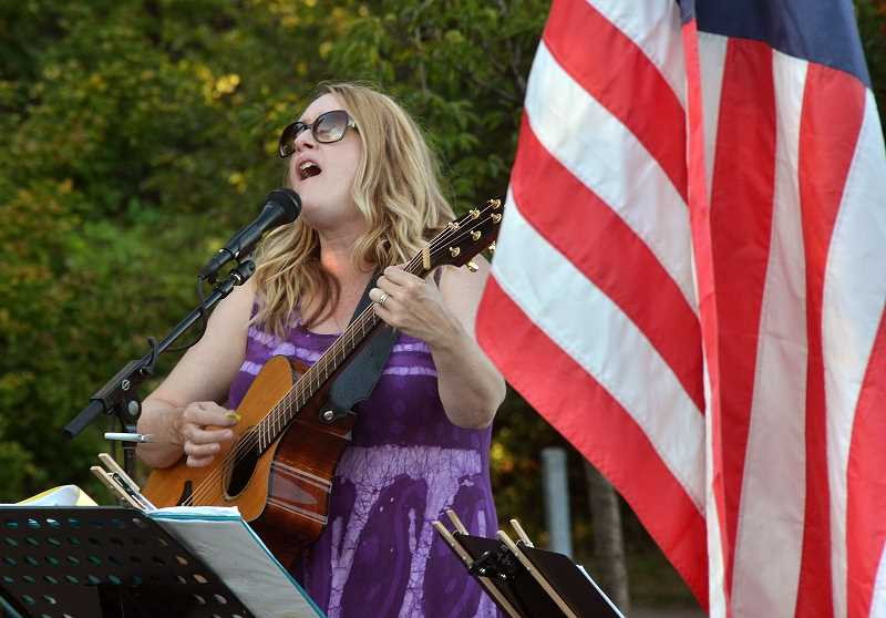 SPOKESMAN PHOTO: VERN UYETAKE - Michele Van Kleef keeps the crowd entertained with live music.