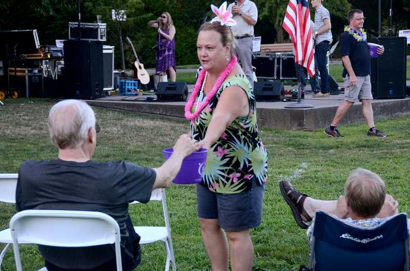 SPOKESMAN PHOTOS: VERN UYETAKE - Bobbi Humphries passes around the collection can for the American Cancer Society.