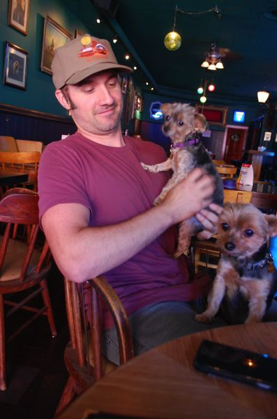 PHOTO BY: RAYMOND RENDLEMAN - Thirsty Duck Saloon owner Luke Forvilly with his 'bosses,' Yorkshire terriers Leo and Alabama.