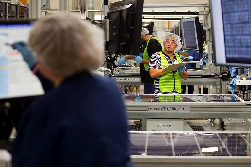 HILLSBORO TRIBUNE FILE PHOTO - Workers inside the SolarWorld plant make solar panels, starting with thin silicon wafers.