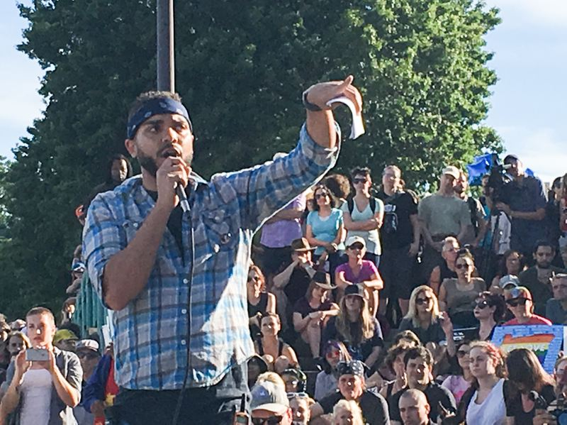PAMPLIN MEDIA GROUP: JOSH KULLA - Portland's Resistance leader Greg McKelvey spoke to the crowd about the Virginia rally and Heather Heyer, who was killed when an Ohio man rammed his car into the crowd.