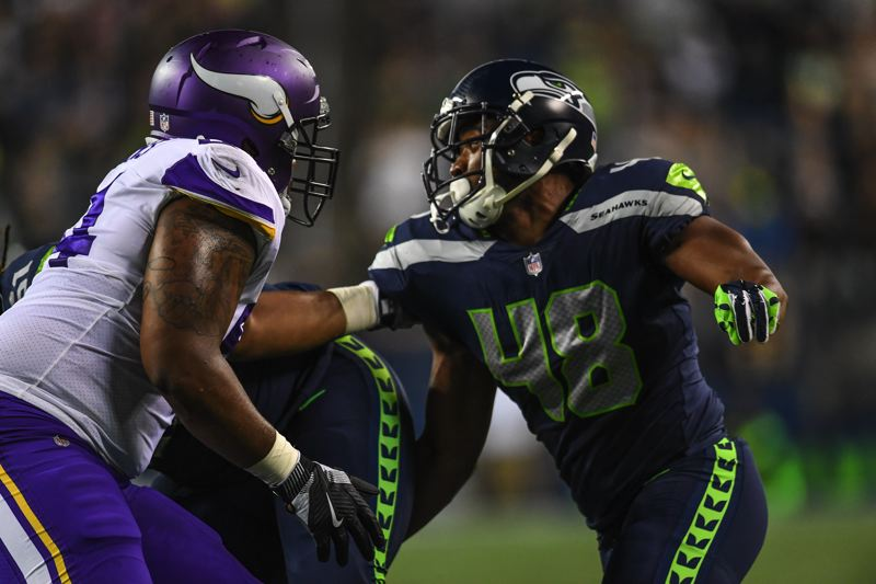 COURTESY: MICHAEL WORKMAN - Seattle defensive end Christian French tries to rush the passer Friday night in an NFL exhibition game against Minnesota.