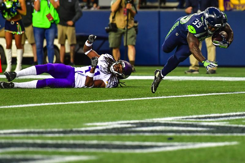 COURTESY: MICHAEL WORKMAN - Mike Davis of the Seattle Seahawks make it into the end zone at the end of a 22-yard pass-and-run play with QB Russell Wilson.