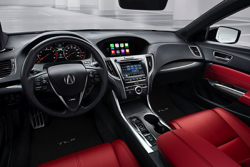 HONDA NORTH AMERICA - The interior of the 2018 Acura TLX A-Spec includes districtive chrome trim and supportive front bucket seats.
