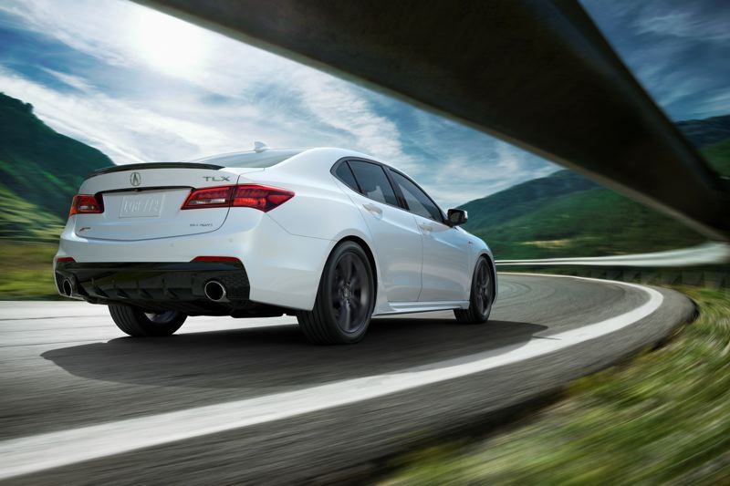 HONDA NORTH AMERICA - The rear of the 2018 Acura TLX A-Spec includes dual chrome exhaust tips and a chrome-trimmed spoiler.