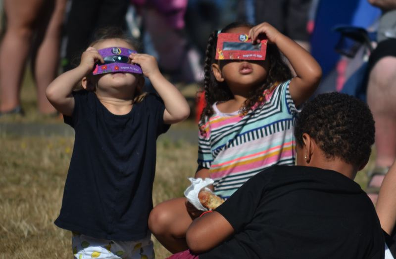 POST PHOTO: BRITTANY ALLEN - For many, this was their first eclipse experience. The library handed out viewers and special activity books to youngsters and parents.