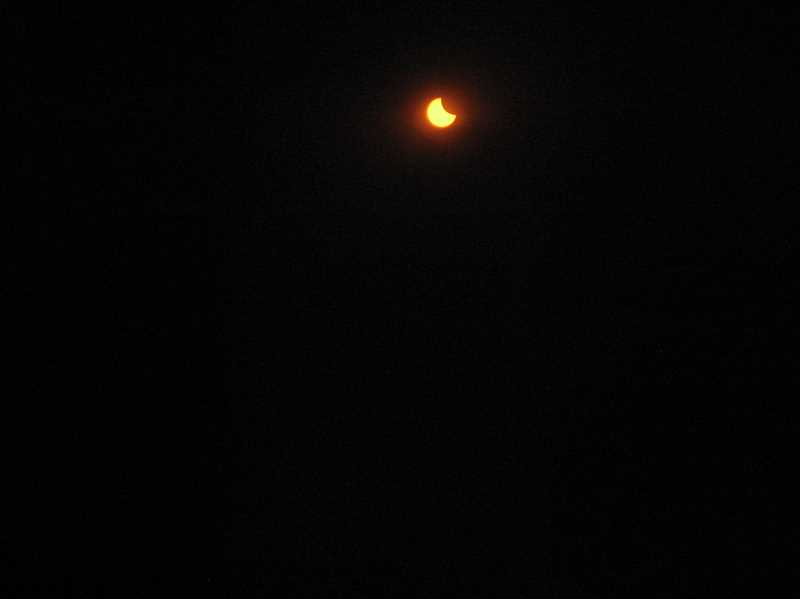 GAZETTE PHOTO: RAY PITZ - Heres what the eclipse looked like shortly after 9:30 a.m. on Aug. 21 at Synder Park.