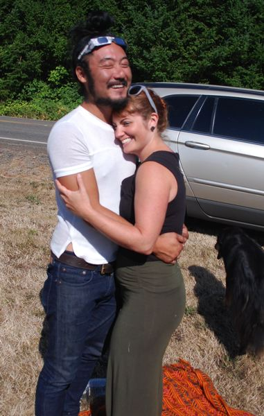 PHOTO BY RAYMOND RENDLEMAN - With a tear in his eye, Alani Vierra hugs Ally Simone as the Portland couple experiences the emotion of viewing an Aug. 21 total eclipse, just south of Oregon City.