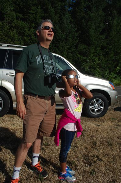 PHOTO BY RAYMOND RENDLEMAN - Oak Grove residents Jon Blackmon and his daughter Joan Marie, 8, view the Aug. 21 eclipse near Clarkes, Oregon.