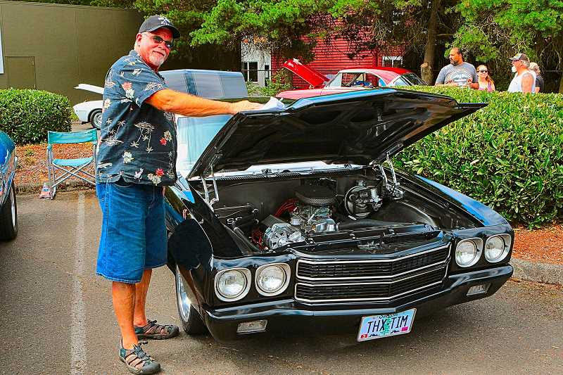 DAVID F. ASHTON - Kevin Ernst brightened the shine on the hood of his 1970 Chevy Chevelle.
