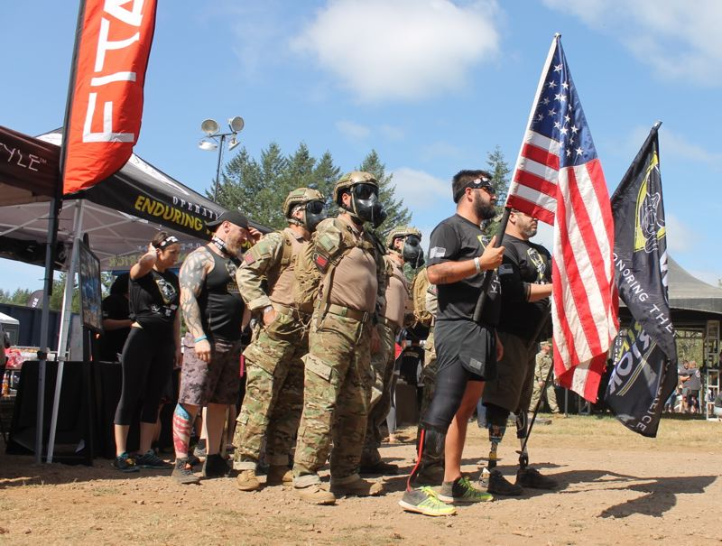 TRIBUNE PHOTO: LYNDSEY HEWITT - Operation Enduring Warrior group lined up before the Spartan Race began.