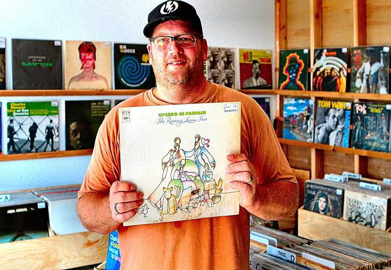 DAVID F. ASHTON - At his new store, Dig Vinyl, Scott Thayer shows a recording by the Ramsey Lewis Trio that hed have passed by as a collector, but now cherishes as a listener.