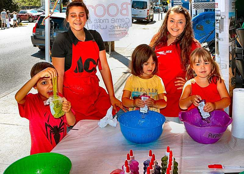 DAVID F. ASHTON - Westmoreland Ace Hardware staffers Jasmine Merrill and Abby Marletto are in the stores slime making booth, helping Cameron, Aubrey, and Mallory Bedwell - to make slime!