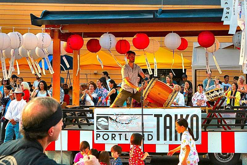 DAVID F. ASHTON - This Portland Taiko drummer pounds out a throbbing rhythm for the Bon Odori dancers.